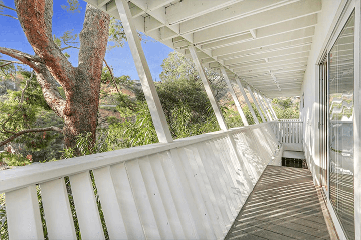 Midcentury dwelling with butterfly roof for sale in Beachwood Canyon