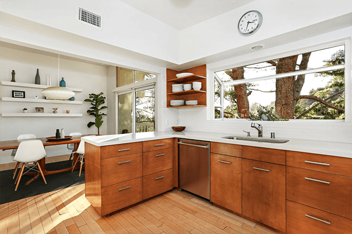 Midcentury home with butterfly roof for sale in Beachwood Canyon