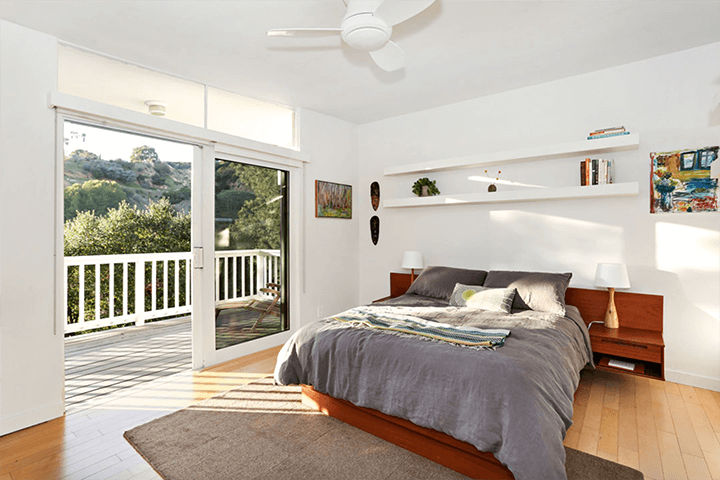 Midcentury house with butterfly roof for sale in Beachwood Canyon